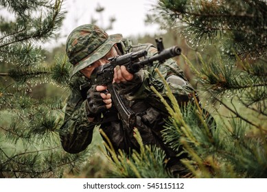 russian paratrooper airborne infantry in the rainy forest