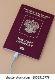 Russian passport with cable connected on a beige background