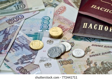 russian passport and few coins on banknotes background