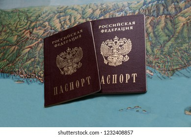 Russian passport on the background of the map.