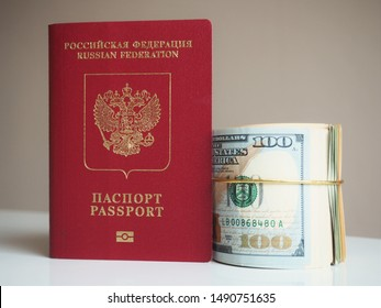 Russian Passport with Us Dollar Bills as stack