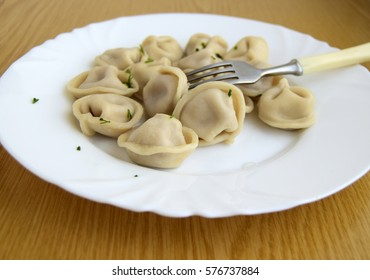 The Russian pelmeni are a dish in the form of boiled products from a fresh dough with stuffing of chopped meat or fish