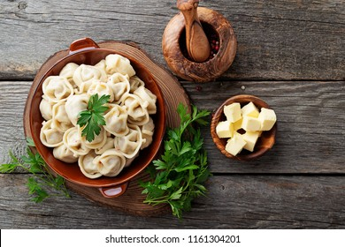Russian pelmeni meat Dumplings with butter and greens.