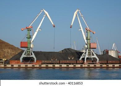 Russian port (harbour) Vladivostok with lifting (hoisting) crane for loading (shipment, lading) cargo ships.
