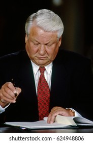 Russian President Boris Yeltsin signs agreement to normalize economic relations with the United States in the East Room of the White House, Washington DC., September 28, 1994.