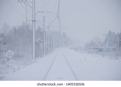 Russian railway in winter. Snow railway. Rails and sleepers.