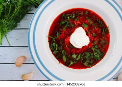 Russian red borsch with sour cream, parsley and dill