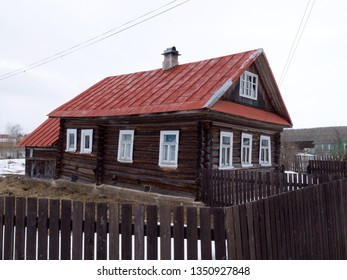 Russian red roof rural log house