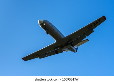 Russian regional jet Yakovlev Yak-40K: three-engined jet airliner, commuter trijet in flight against blue sky in clear sunny day. Tail number RA-87947. Kamchatka Peninsula, Russia - September 13, 2019