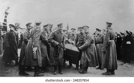 Russian Revolution. Funeral of 182 persons killed by Czarist police on Feb. 26, 1917. Soldiers carrying coffin, St. Petersburg, Russia.