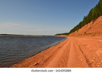 Russian river Mezen, road on the river bank