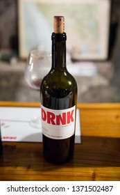 Russian River Valley, CA - April 5, 2019: Red wine bottle during a tasting at the DRNK Winery located in an underground cave in the Russian River Valley of California.