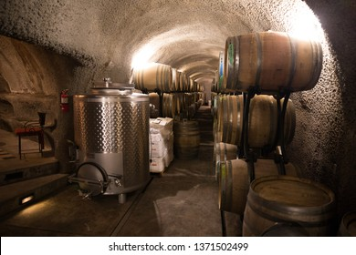 Russian River Valley, CA - April 5, 2019: Wine barrels and winemaking production equipment at the DRNK Winery located in an underground cave in the Russian River Valley of California.