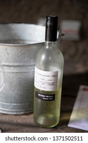 Russian River Valley, CA - April 5, 2019: Sauvignon Blanc next to a bucket of ice at the DRNK Winery located in an underground cave in the Russian River Valley of California.