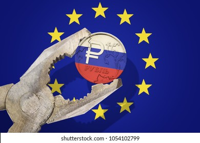 Russian ruble coin being squeezed in vice on the European Union (EU) flag background. Concept new sanctions russia