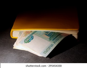 Russian Rubles in the Book in the Dark Room