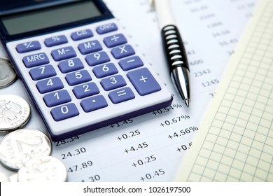 Russian rubles with calculator and pen closeup