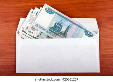 Russian Rubles in Envelope on the Table closeup