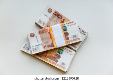 Russian rubles isolated on white background, packed stack of banknotes 5000 rubles