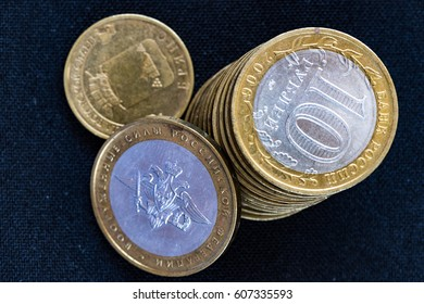 Russian rubles metallic coins on a textured surface