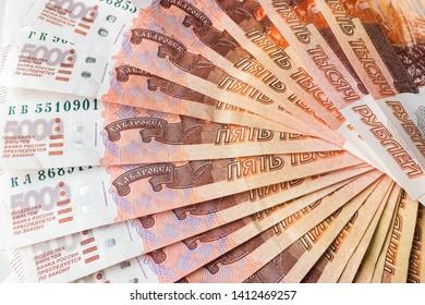 Russian rubles are on a homogeneous background, bills five thousand rubles, money fan