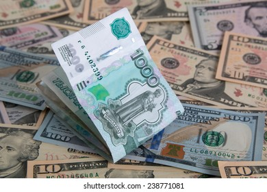 Russian rubles on USA dollars background