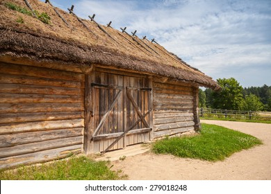 Russian rural wooden architecture example, old barn with locked gate