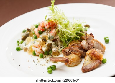 Russian salad with quail
