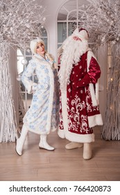 Russian Santa Claus (Grandfather Frost) and Snow Maiden in the New Year's interior