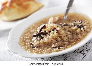 Russian sauerkraut soup with mushrooms and pearl barley