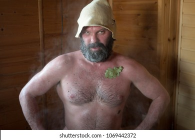 Russian sauna. A man in a couple's clubs on vacation after a steam room.