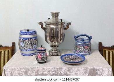 Russian silver samovar and wooden tableware painted northern Vologda Khokhloma