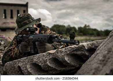 Russian sniper hidden behind concrete block