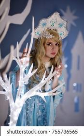 Russian Snow Maiden in blue suit and kokoshnik