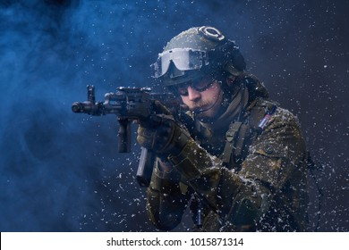 Russian soldier aiming with Kalashnikov AK in winter