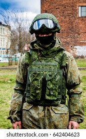 russian soldier in ammunition at the city