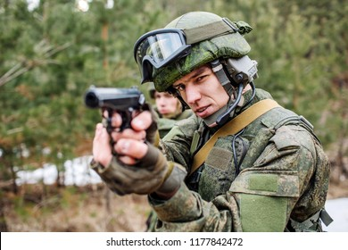 Russian soldier  holding black pistol. Image on a white background.