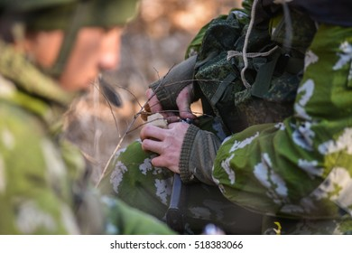 Russian soldiers charging machine cartridges close up