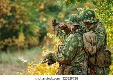 russian soldiers holding gps in hand and determines the location of coordinates