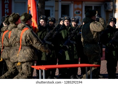 Russian soldiers recruits stand in a row with Kalashnikov rifles for the oath on square on november 18, 2018 on Boguchar, Russia. Russian infantry in the square.