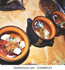 Russian soup with meat and vegetables, uncooked in a clay pot