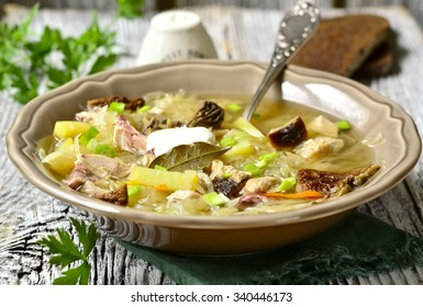 Russian sour cabbage soup (shchi) with dried mushrooms.