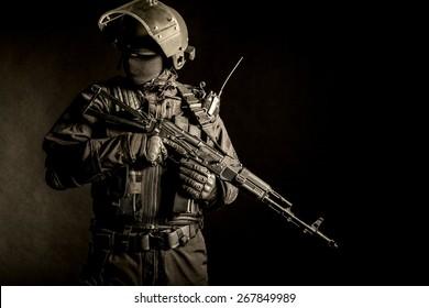 Russian special forces operator in black uniform and bulletproof helmet