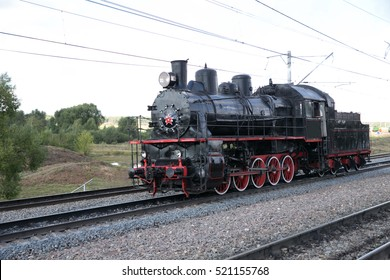 Russian steam locomotive on the background of a stormy sky