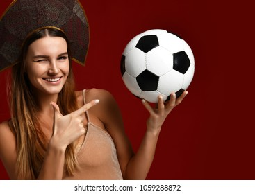 Russian style Fan sport woman player in kokoshnik cap hold soccer ball celebrating happy smiling laughing with free text copy space isolated on white background