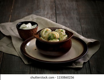 russian style food. Dumplings pelmeni in the wooden table. rustic
