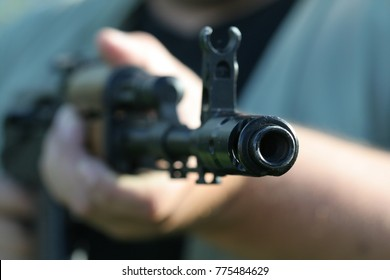 russian submachine-gun ak-47 in somebody's hands