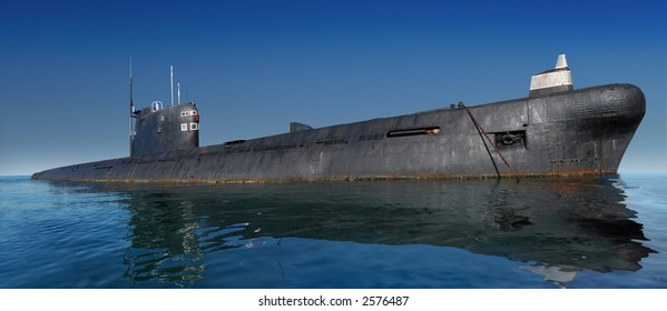 Russian submarine surfaced. Shot at water level against clear blue sky