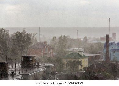russian suburbs roofs under heavy rain telephoto shot
