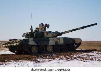 Russian tank at the landfill. Practice shooting